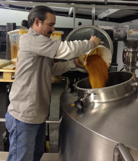 Garr Schwartz brewing Country Roots, the sweet potato stout.
