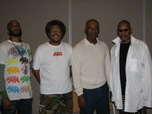 From left: Cirroc Lofton, Cass Teague, Michael Dorn and Avery Brooks. Brooks played Ben Sisko, Dorn played Worf, and Lofton played Jake Sisko on Star Trek Deep Space Nine. Photo taken at Dragon Con in 2008.