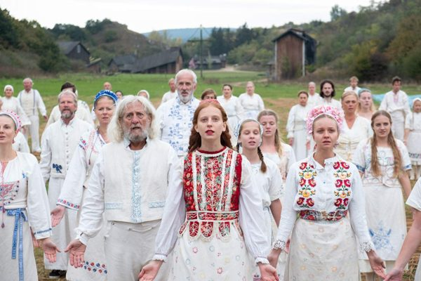 Group of people wearing white, festival clothing in the movie Midsommar