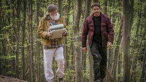 Nick Nolte and Gerard Butler walking in the forest