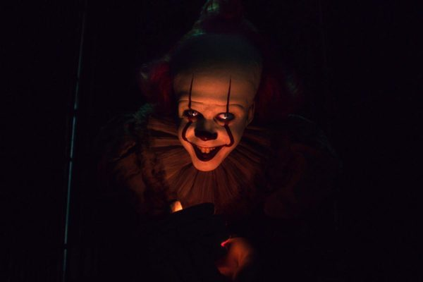 Pennywise the Dancing Clown with a candle light under his face