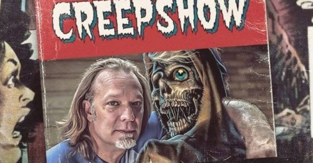 Greg Nicotero posing with the Creepshow mascot