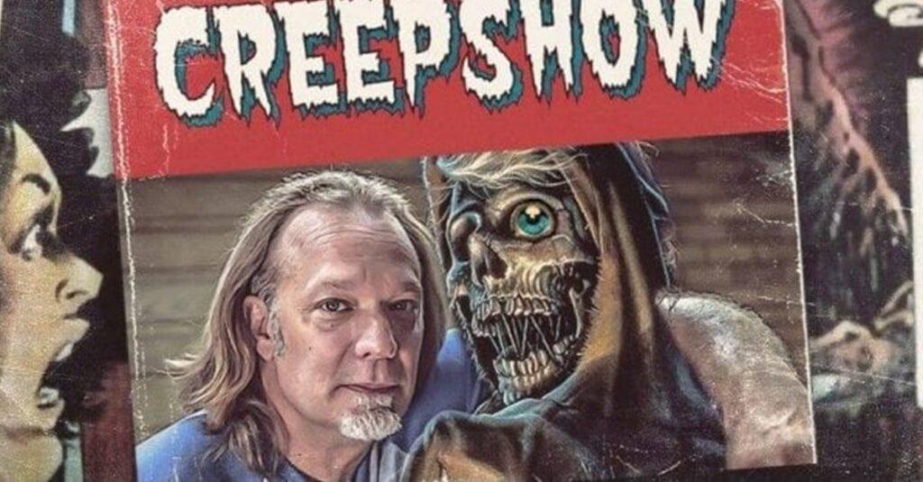 Greg Nicotero posing with the Creepshow mascot