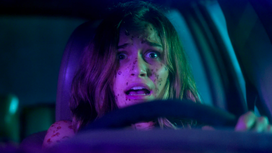 Scared injured woman driving car