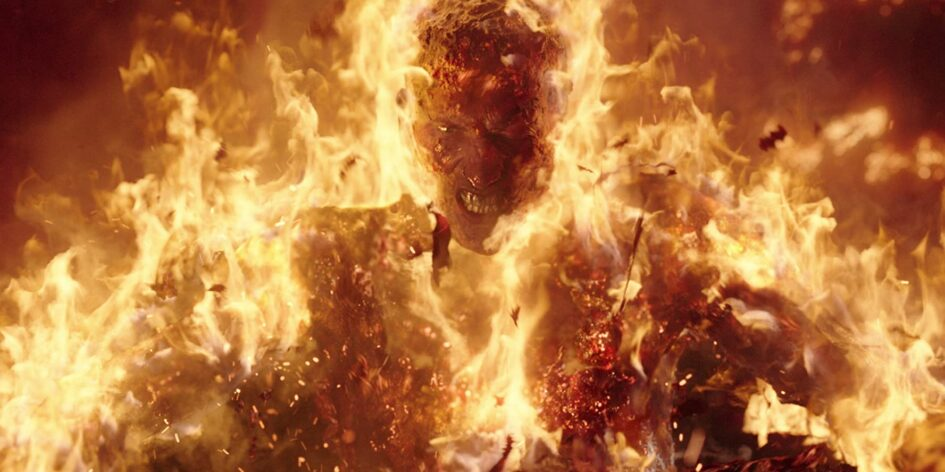 Man covered in fire with angry look on his face