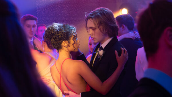 Taylor Russell and Charlie Plummer dancing in WORDS ON BATHROOM WALLS