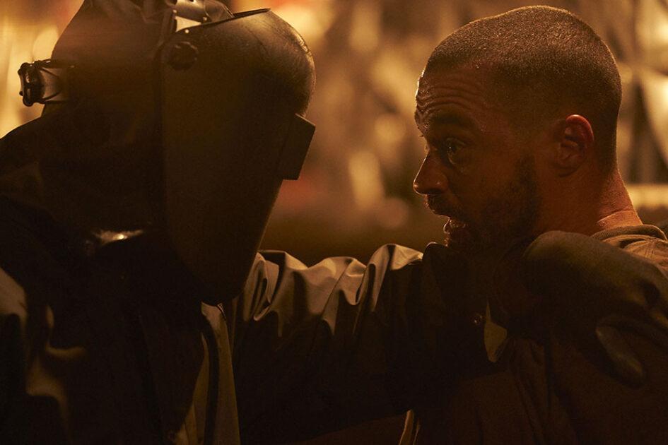 Man in welder helmet fights unarmed man